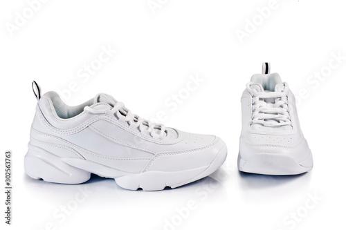 White sneakers isolated on a white background. Obraz na płótnie