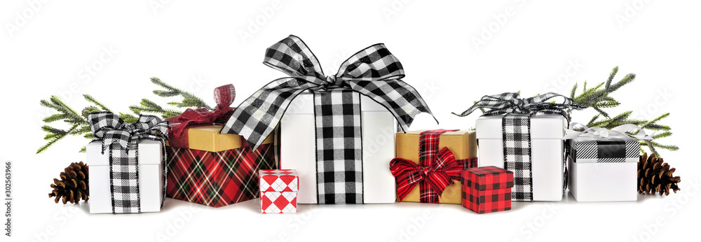 Fototapeta Assortment of many Christmas gift boxes with plaid wrap and ribbon and tree branches isolated on a white background