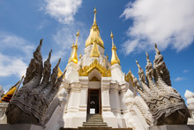 Golden And White Pagoda At Wat Tham Khuha Sawan Temple, Ubon Ratchathani Province, Thailand