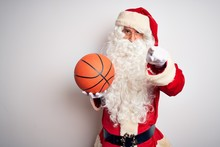 Senior Man Wearing Santa Claus...