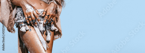 close up of young fashionable stylish woman with tanned skin wearing stylish boh Wallpaper Mural