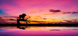 canvas print picture - Amazing sunset and sunrise.Panorama silhouette tree in africa with sunset.Tree silhouetted against a setting sun.Dark tree on open field dramatic sunrise.Safari theme.Giraffes   Lion   Rhino