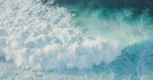 Aerial View Of A Blue Ocean Wave Breaking With Spray At Sunset, White Water Tsunami Wave Rushing Towards The Camera, Ocean White Water Textures