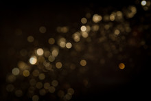Gold Abstract Bokeh On Black