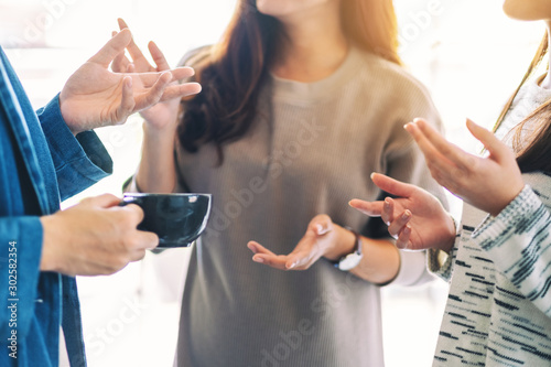 Close up image of people enjoyed talking and drinking coffee together Wallpaper Mural