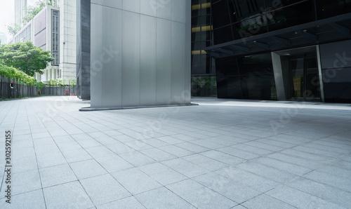 Valokuvatapetti Empty ground in front of modern buildings .