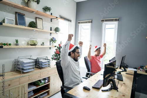 portrait of asian worker team working in the office during christmas season