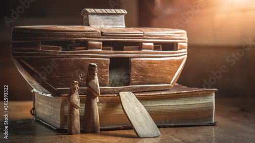 Fotografiet Noah's Ark on the Bible, story in Bible, Wood carving doll, christian concept