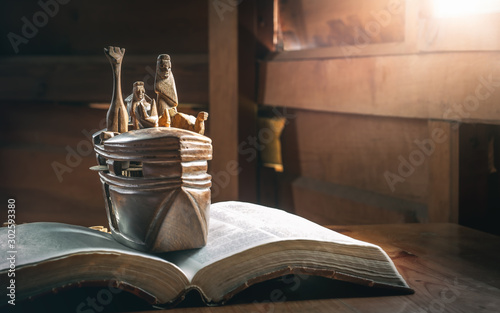 Fotografia Adventure of Noah's Ark with animals, story in Bible, Wood carving doll, christian concept