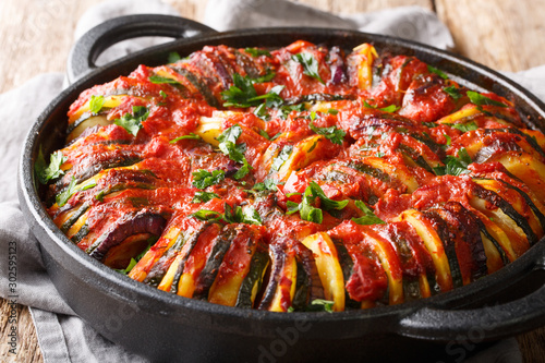 Cuadros en Lienzo  Mediterranean baked various vegetables in tomato sauce close-up in a pan