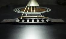 Black Guitar On A Dark Background