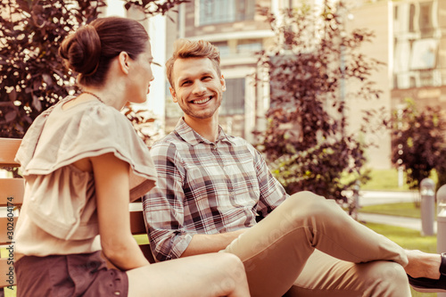 Positive delighted young people having pleasant conversation