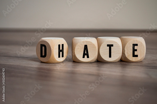Cubes and dice with the opposite of hate and date on wooden background Wallpaper Mural