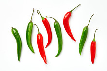 Red And Green Chili Pepper On A White Background. Red And Green Chili Pepper Of Different Shapes Isolated On White Background