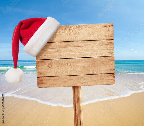 Christmas party on beach signboard as background Wallpaper Mural