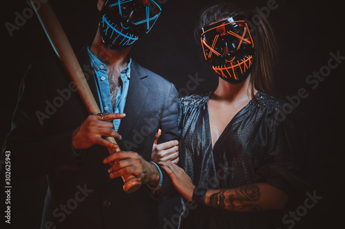 Young family in scary masks are posing for photographer with baseball bat in hands Canvas Print