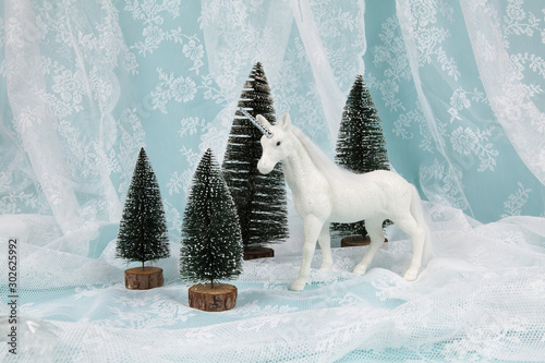 Foto auf Leinwand Fantasie-Landschaft snow unicorn on a lace background