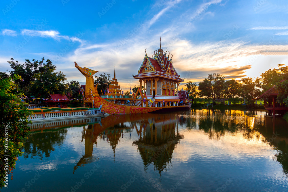 Fototapety, obrazy: A huge Thai Suphannahong, also called Golden Swan or Phoenix boat at the WatpahSuphannahong Temple twilight time in sisaket, Thailand