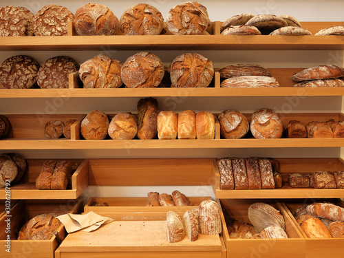 Fototapeta Modern bakery with different kinds of bread, cakes and buns obraz