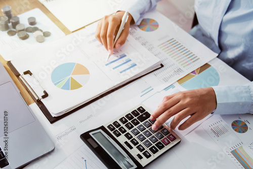 Fototapeta .Business woman working in finance and accounting Analyze financial budget in the office obraz