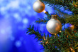 Leinwanddruck Bild - Christmas toys on the Christmas tree, with a beautiful blue bokeh. Background for cards and greetings