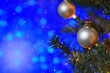 canvas print picture - Christmas toys on the Christmas tree, on a blue bokeh background, with snow. New Year card