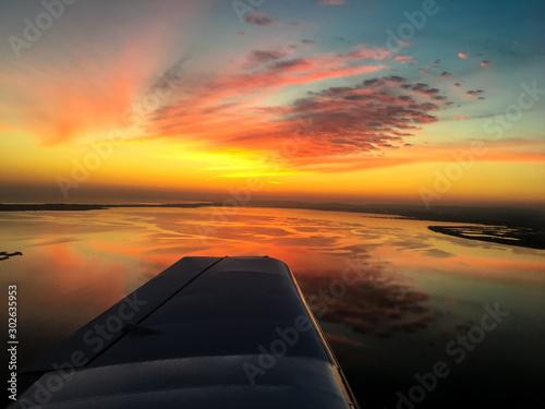 Fototapeta Sunset over plane's wing
