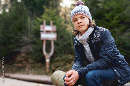 Teenage boy in the autumn forest