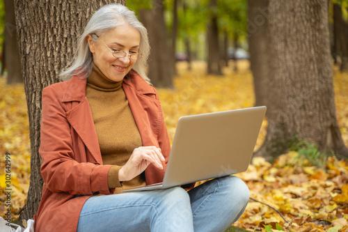 Freelancer enjoying her work in the open air