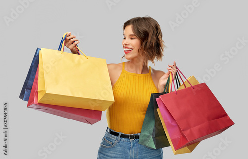 Cuadros en Lienzo  sale and people concept - happy smiling young woman in mustard yellow top and je