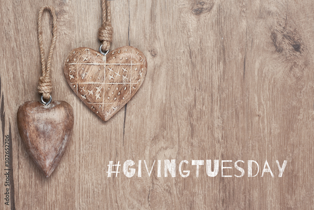 Fototapety, obrazy: Giving Tuesday, global day of charitable giving. Give help, donations and support. Wooden hearts, flat lay on wood with text. Givingtuesday is a global charity campaign - Black Friday of Charity.
