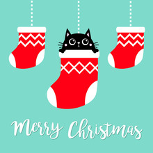 Merry Christmas. Hanging Christmas Red Socks Dash Line. Black Cat Head Face Head. Cute Cartoon Kawaii Baby Character. Flat Design. Blue Background.