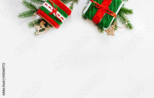 Fototapeta Christmas gift boxes and decor in snow. Isolated on white background  obraz na płótnie