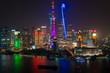 View over Huangpu River & Pudong skyline at night, Shanghai, China