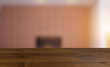 Empty interior with large window. Retro light bulb. The floor is of brown parquet. 3D rendering. wooden table. blurred background