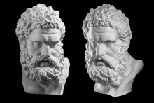 Two Bust Of Hercules. Heracles Head Sculpture, Plaster Copy Of A Statue Isolated On Black. Son Of Zeus. Ancient Statue Of Hero.