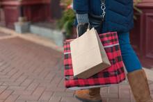 Woman Carrying Shopping Bags A...