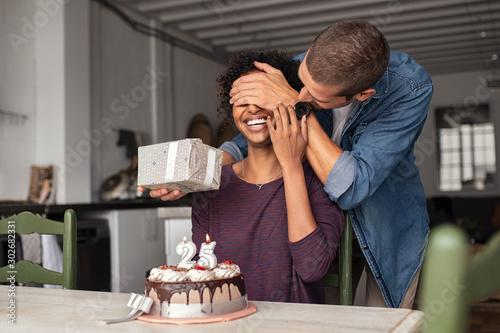 Fototapeta  Man surprising girl on birthday