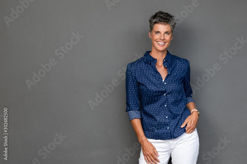 Successful mature woman standing
