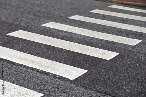 Obraz Crosswalk on the asphalt road.Road Safety - fototapety do salonu