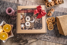 Box Full Of Christmas Sweet Cokies And Pastry With Red Ribbon