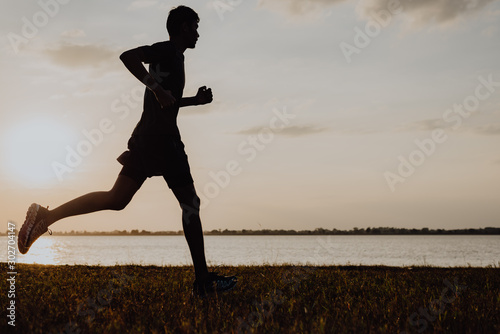 Obraz Athlete runner feet running on road, Jogging at outdoors. Man running for exercise.Sports and healthy lifestyle concept. - fototapety do salonu