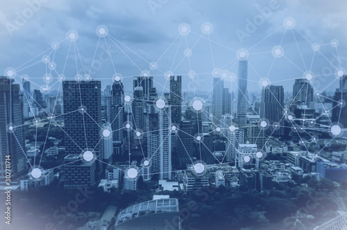 Fototapeta Network and Connection technology concept with city background obraz