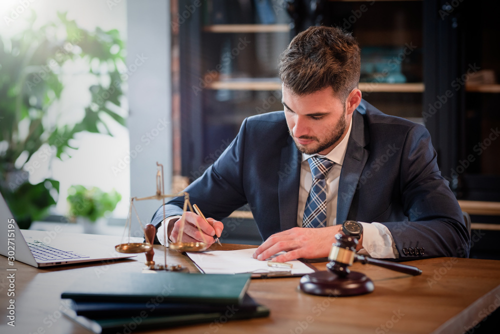 Fototapeta Lawyer or attorney working in the office
