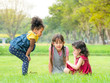 canvas print picture - A group of young children of many nationalities play and learn outside of school