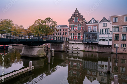 Valokuvatapetti City scenic from the medieval town Gorinchem in the Netherlands at sunset