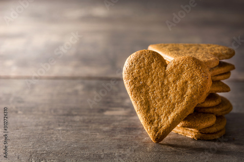 Fototapeta Heart shaped cookie on wooden table with copy space. Valentine's Day and Mother's Day concept. obraz