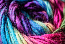 Closeup Of Deep Rich Jewel Tone Rainbow Variegated Skein Of Yarn