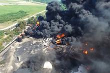 Oil Storage Fire. The Tank Farm Is Burning, Black Smoke Is Combu