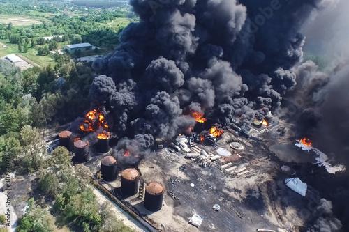 Oil storage fire. The tank farm is burning, black smoke is combu Wallpaper Mural